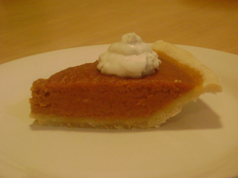 pumpkin pie w/ coconut whipped cream